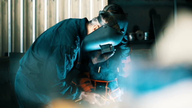 welders working together 4k - metal worker stock videos and b-roll footage