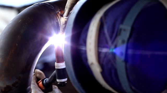 hd: welding a pipe - plumber stock videos & royalty-free footage