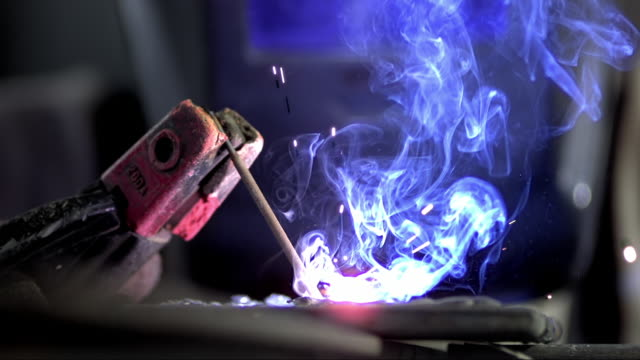 slo mo welding electrode used in arc welding - welding stock videos & royalty-free footage