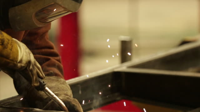 welding in a manufacturing plant - steel stock videos & royalty-free footage