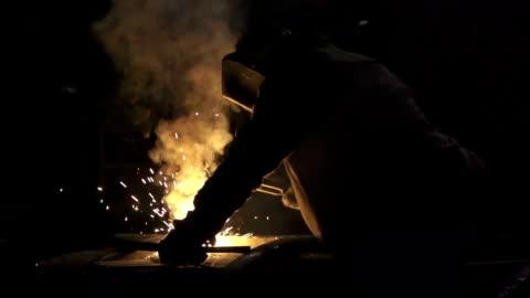 welding in backlight - welding stock videos & royalty-free footage