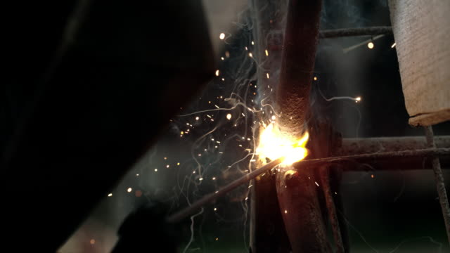 slo mo welding in close up shot - metal industry stock videos & royalty-free footage