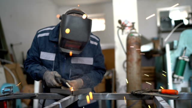welding in workshop - steel worker stock videos & royalty-free footage