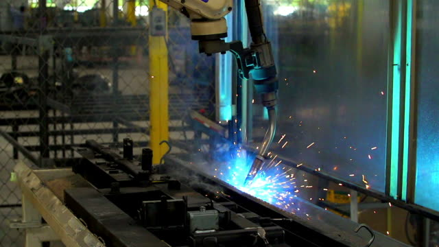 hd: welding robot movement in automotive assembly factory - shoes in a row stock videos & royalty-free footage