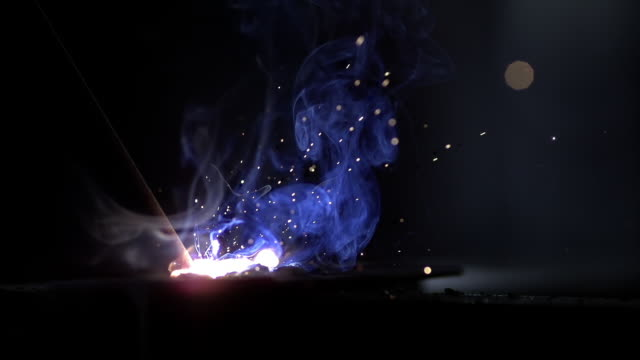 SLO MO Welding sparks and gases shining in the dark
