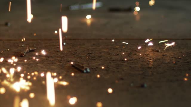 vídeos de stock, filmes e b-roll de cu welding sparks falling on the floor / orem, utah, usa. - orem