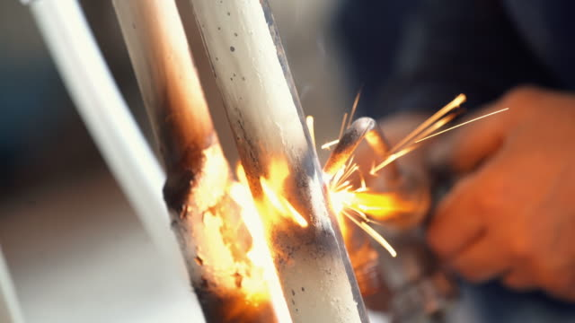 welding two pieces of metal. - plumber stock videos and b-roll footage