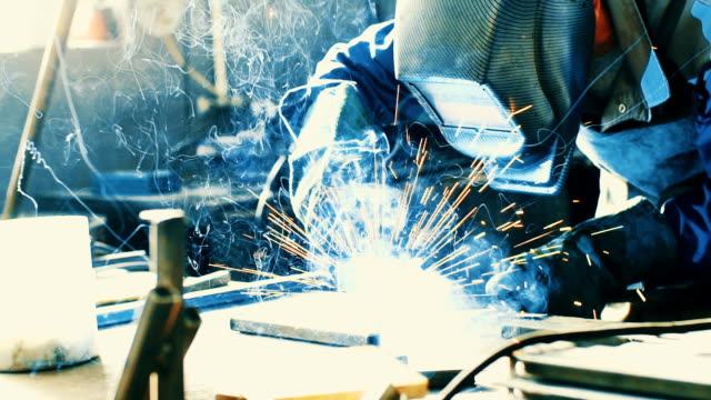 welding two steel tubes in slo mo. - welding stock videos and b-roll footage