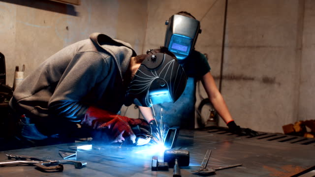 welding with daughter - trainee stock videos & royalty-free footage
