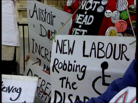 government rebellion; ext disabled protestor outside parliament disabled protestors in wheelchairs and holding placards woman holding placard man... - disability stock videos & royalty-free footage