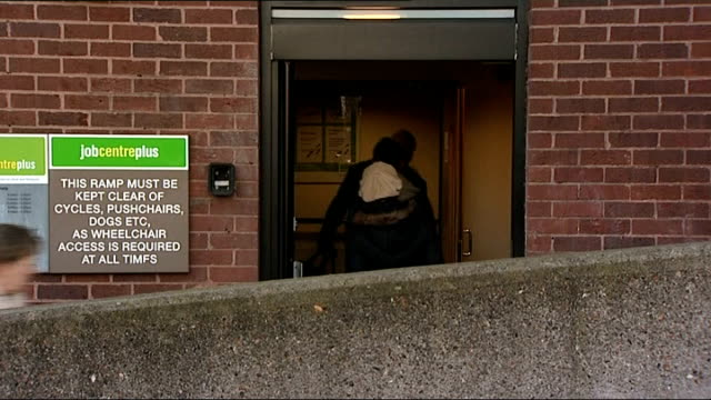 universal credit system criticised by public accounts committee date location unknown people arriving at job centre 'jobcentreplus' sign on wall - social services stock videos & royalty-free footage
