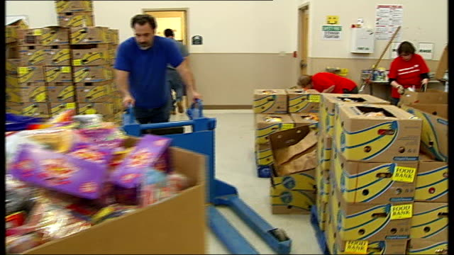 rise in use of food stamps providence ext gvs exteriors of 'rhode island community food bank' gvs workers packing boxes at community food bank cindy... - food stamps stock videos & royalty-free footage