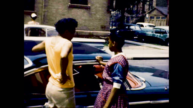well dressed african american women posing for the camera on the stairs and street; two women with matching dress, walking and laughing next to stop... - african ethnicity stock videos & royalty-free footage
