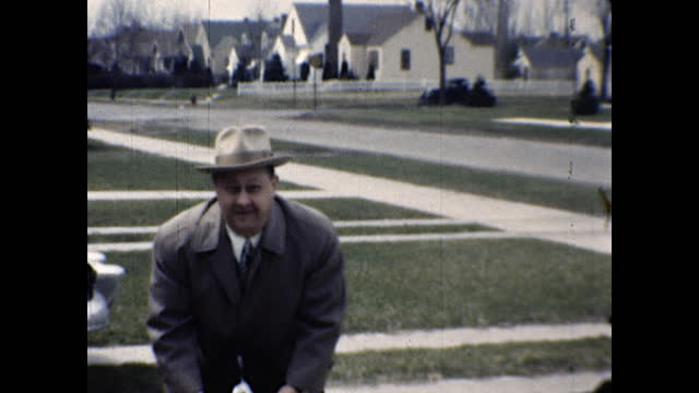 well dressed family getting ready to pose for a photo standing in front of the driveway, man whistles and dog comes; man with a camera talking to... - 1940 1949 stock videos & royalty-free footage