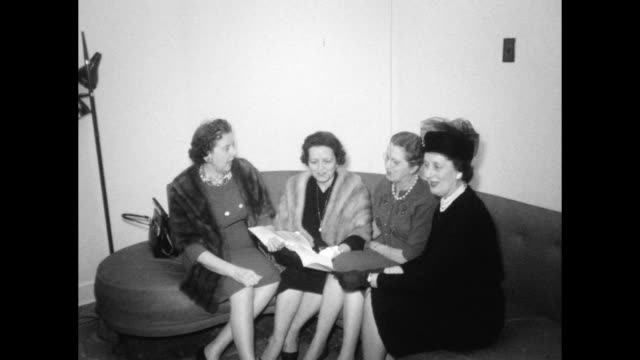 Well Dressed High Society Older Women Sit on a Couch Talk Nashville Tennessee Fashion of the 1950s