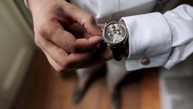 well dressed man checking time on his wrist watch - well dressed stock videos & royalty-free footage