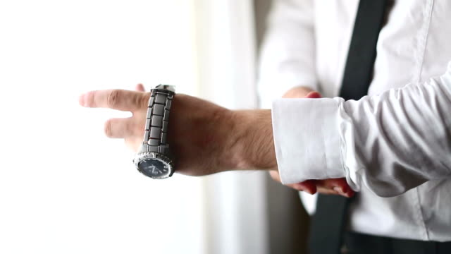 well dressed man putting his wrist watch - shirt stock videos & royalty-free footage
