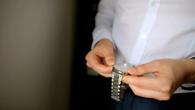 well dressed man putting his wrist watch - instrument of time stock videos & royalty-free footage