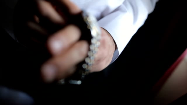well dressed man putting his wrist watch - getting dressed stock videos & royalty-free footage