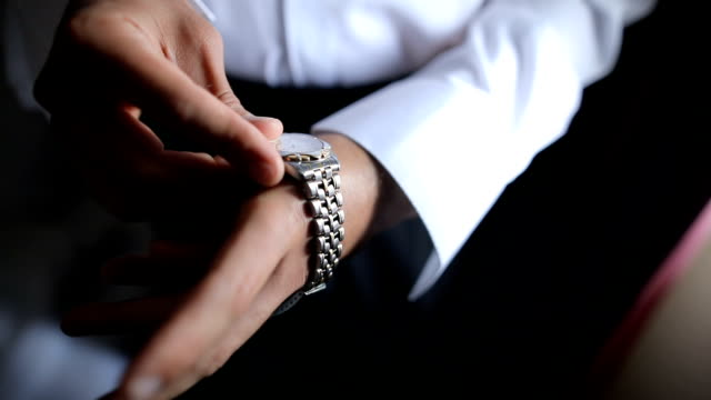 well dressed man putting his wrist watch - necktie stock videos & royalty-free footage
