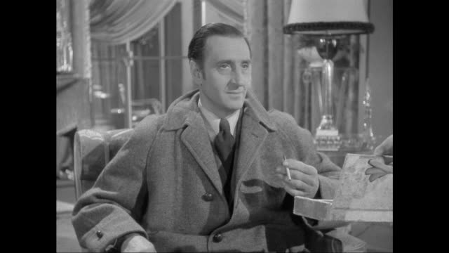 1946 well dressed woman (patricia morison) offers cigarette to sherlock holmes (basil rathbone) - thank you stock videos and b-roll footage