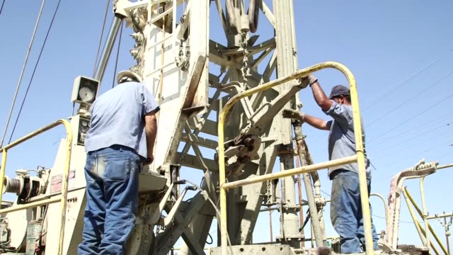 well drilling for groundwater in fresno california on september 23 close up pans of drilling rig and workers adjusting equipment wide shot of... - groundwater stock videos and b-roll footage