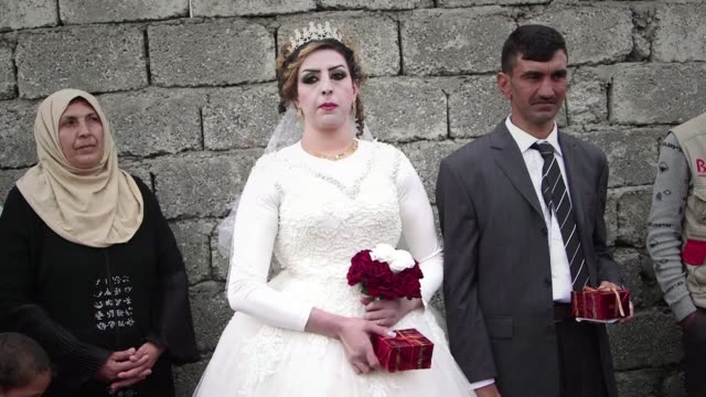 well wishers danced in defiance of the islamic state group on thursday at the wedding of a bride and groom among families who fled the jihadists... - iraq stock videos & royalty-free footage