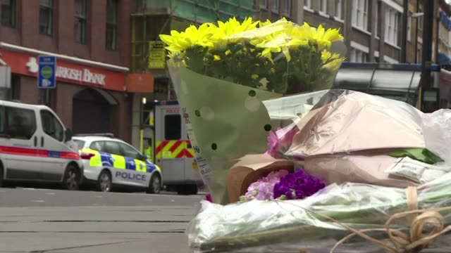 well wishers lay flowers close to london bridge where a van smashed into pedestrians before three assailants went on a stabbing spree - terrorism stock videos & royalty-free footage