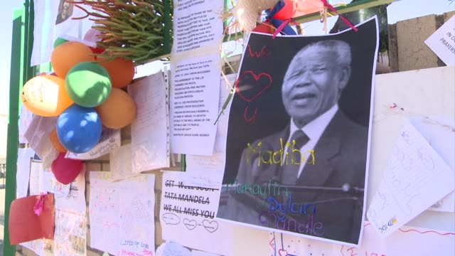 well wishers leave messages of support for nelson mandela outside the hospital where he is being treated as a 19 day vigil for the anti apartheid... - apartheid stock videos and b-roll footage