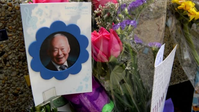 Well wishers place flowers and messages outside the Singapore General Hospital where elder statesman Lee Kuan Yew remains critically ill in the...