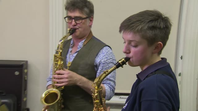 wellchild awards recognise bravery of seriously ill children emily wright playing saxophone with nigel ellis sot - woodwind instrument stock videos and b-roll footage