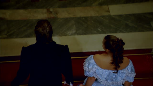 stockvideo's en b-roll-footage met a well-dressed couple walks into the ballroom of a mansion in st. petersburg, russia. - avondjurk