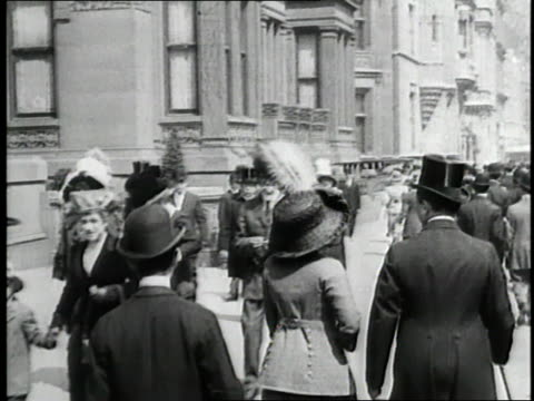 a welldressed crowd of pedestrians moves along the streets of new york city - wealth stock videos & royalty-free footage