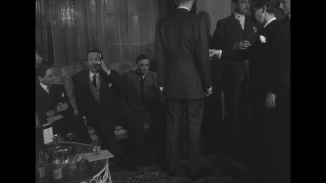 well-dressed men at party drinking and talking, actor and comedian terry-thomas sitting on couch second from left / two men walk into room / man on... - comedian stock videos & royalty-free footage