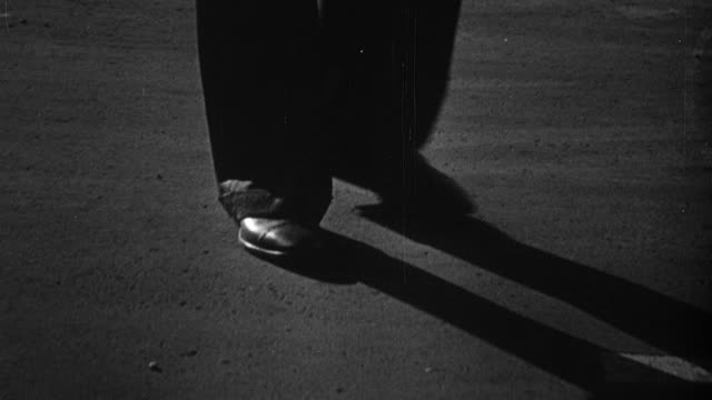 1948 montage well-dressed pedestrian walking, signs on doors, and nightlife in clubs / sheffield, england, united kingdom - シェフィールド点の映像素材/bロール