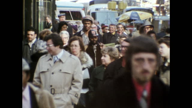 well-dressed people walk along street in new york city; 1975 - walkable city stock videos & royalty-free footage