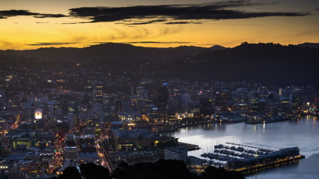 wellington cityscape - sunset to night time lapse - new zealand stock videos & royalty-free footage
