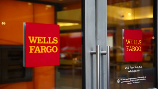 a wells fargo branch in new york us on july 13 shots shot of wells fargo doors showing signage as people walk by tighter shot of glass doors with... - wells fargo stock videos and b-roll footage