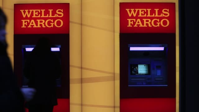 a wells fargo co bank branch stands in washington dc us on thursday jan 7 2016 wells fargo co is scheduled to report fourthquarter earnings on jan 15... - wells fargo stock videos and b-roll footage