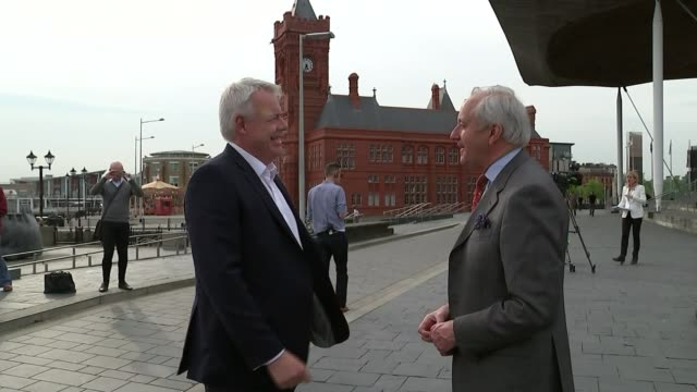welsh assembly elections: results; wales: cardiff: ext carwyn jones am shaking hands with neil hamilton am outside weslh assembly building - mid wales stock videos & royalty-free footage