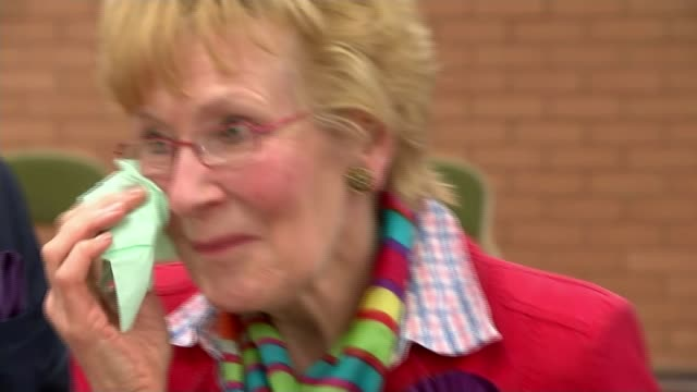 welsh assembly elections: results; wales: carmarthenshire: int neil and christine kiss christine hamilton wiping tears from her eyes reporter... - mid wales stock videos & royalty-free footage