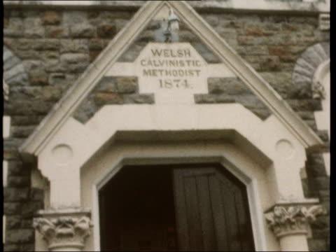 "welsh drinking; gv chapel zoom to ""baptist soar chapel"": av ""welsh calvenistic methodist"" tilt open chapel door: track singing congregation: cms... - congregation stock videos & royalty-free footage"