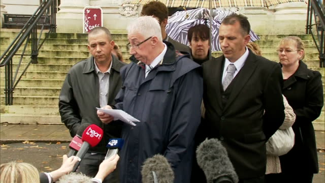 Welsh farmer jailed for 'slavery' case WALES Cardiff Cardiff Crown Court EXT Darrell Simester from court with others/ Tony Simester reading statement...