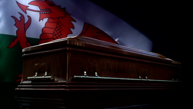 welsh flag behind coffin - cardiff wales stock videos & royalty-free footage