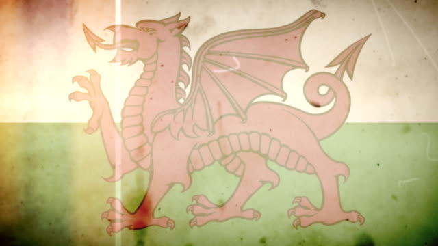 welsh flag - grungy retro old film loop with audio - wales stock videos & royalty-free footage