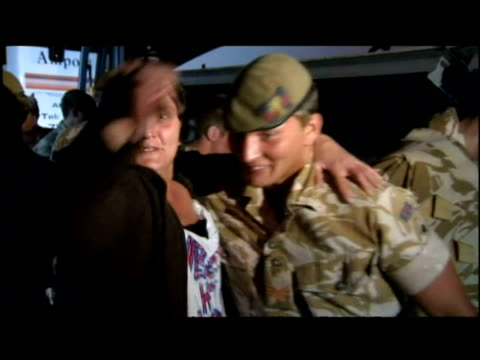 welsh guards greet loved ones at homecoming from afghanistan - 2001年~ アフガニスタン紛争点の映像素材/bロール