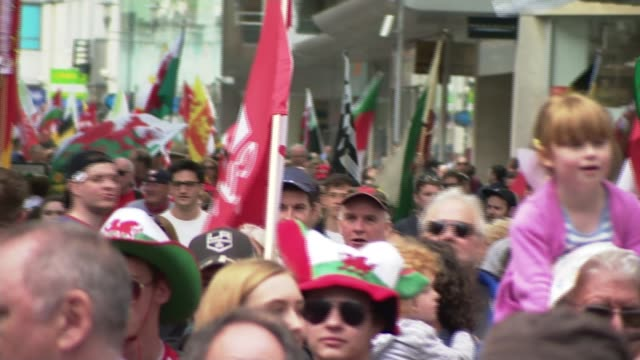welsh independence march in cardiff; wales: cardiff: ext various of demonstrators marching in support of welsh independence - with large banner... - cardiff wales stock videos & royalty-free footage