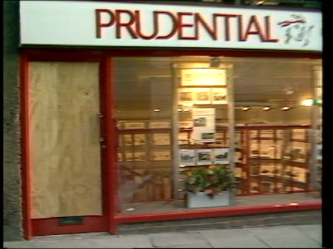 welsh nationalist fire bombs itn chester ext ms 'prudential' estate agent's officefront window with boarded up door pull out pan rl main street ms... - itv late evening bulletin stock videos and b-roll footage