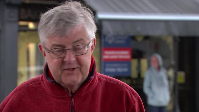 welsh parliament elections: labour party one short of a majority; wales: porthcawl: int raindrops on window pull focus people and media waiting for... - channel 4 news stock videos & royalty-free footage