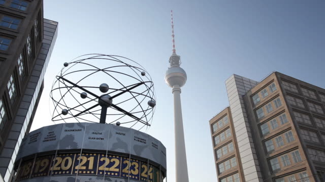 MS Weltzeituhr and television tower on Alexanderplatz / Berlin, Berlin, Germany